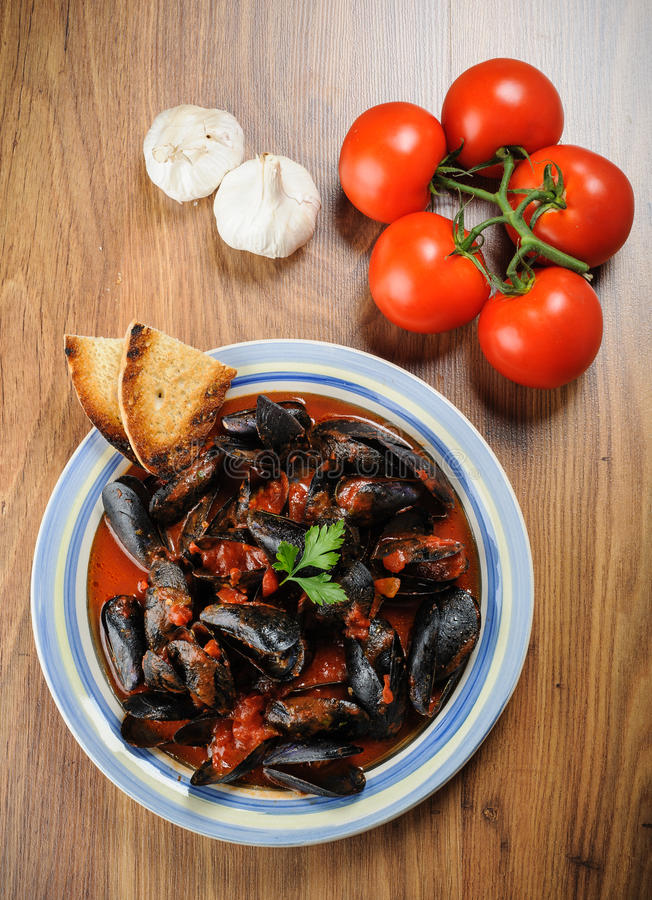 Zuppa di cozze - Impepata di Cozze - mussel soup. Mussel soup, traditional italian dish royalty free stock photos