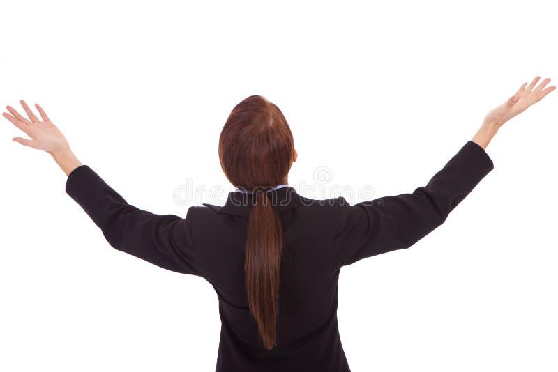 Zurück von einer Geschäftsfrau, die ihre Hände hochhält lizenzfreies stockbild
