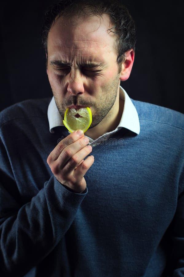 Zure citroenuitdrukking royalty-vrije stock afbeeldingen