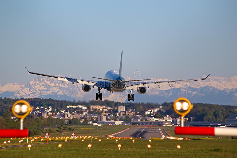Zurich airport. ZURICH - MAY 5: Oman Air A-330 landing in Zurich airport after short haul flight on May 5, 2016 in Zurich, Switzerland. Zurich airport is home royalty free stock photography