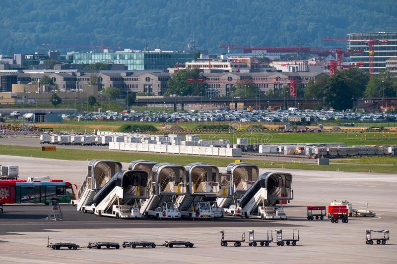 Zurich airport panoramic landscape at day time, ladders, luggage trolleys and other airport special machines stock photos