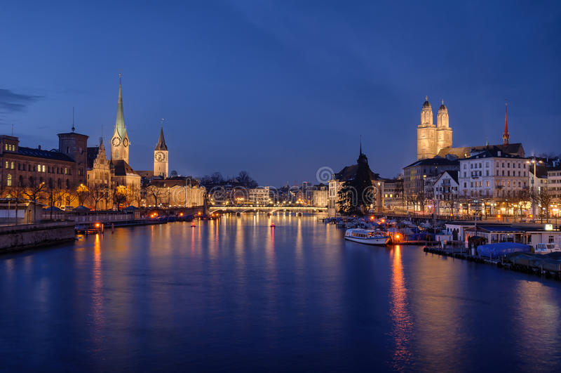 Zurich city center viewed from the river by night royalty free stock images