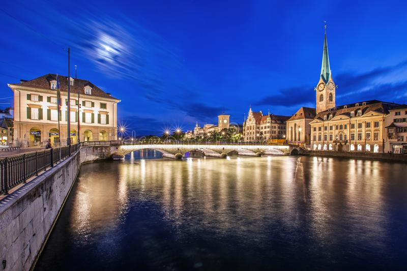 Zurich city by night with the river limmat royalty free stock photography