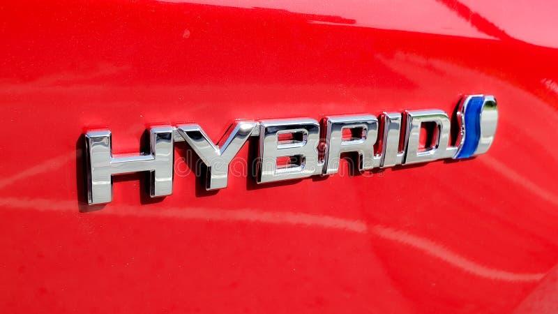 Zurich Schweiz - Juni 2019: Closeup av Toyota det hybrid- emblemet royaltyfri bild