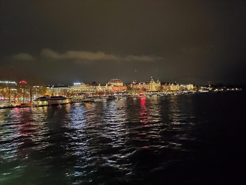 Zurich Switzerland night cityscape seen from the lake shore stock photography
