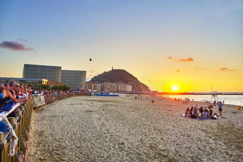 The Zurriola Beach at sunset with the Monte Urgull in the background. San Sebastian, Basque Country. Spain. royalty free stock photo