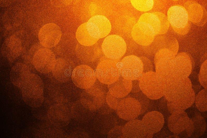 Zusammenfassung bokeh hellbraune und gelbe Farbdefocused Kreissommerhintergrund Weihnachtslicht oder Grußhintergrund der Jahresze stockfotografie