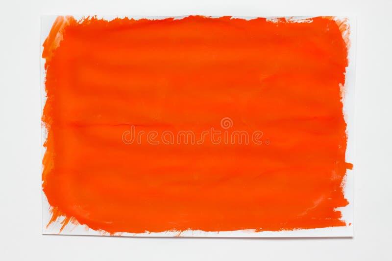Zusammenfassung gemaltes orange Segeltuch Ölfarben auf einer Palette stockfotografie