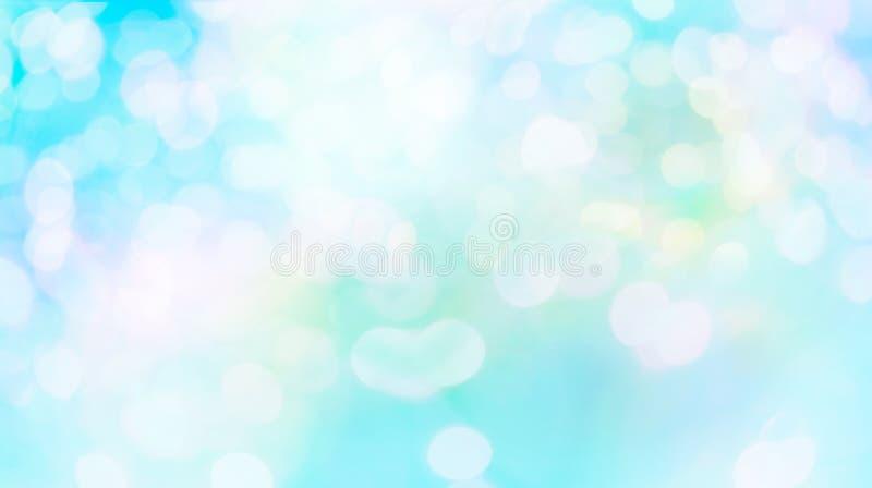 Zusammenfassungsunschärfe weiße bokeh Kreise im blauen Hintergrund lizenzfreie stockfotografie