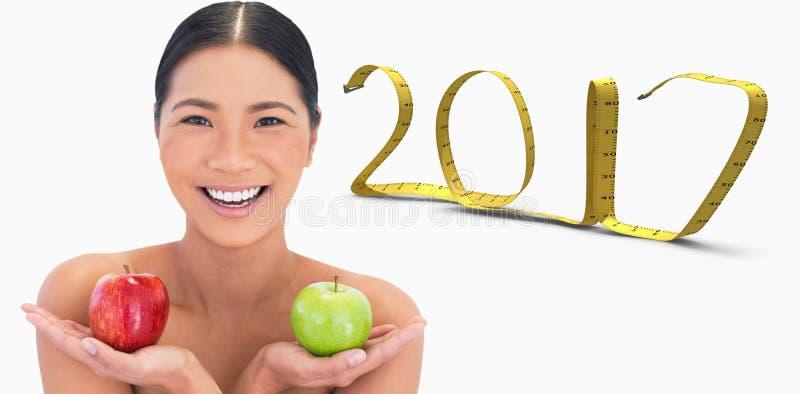zusammengesetztes Bild 3D des lächelnden natürlichen Brunette, der Äpfel in beiden Händen hält lizenzfreie stockfotografie
