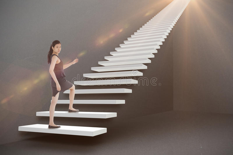 Zusammengesetztes Bild der Geschäftsfrau 3d steigernd lizenzfreies stockbild