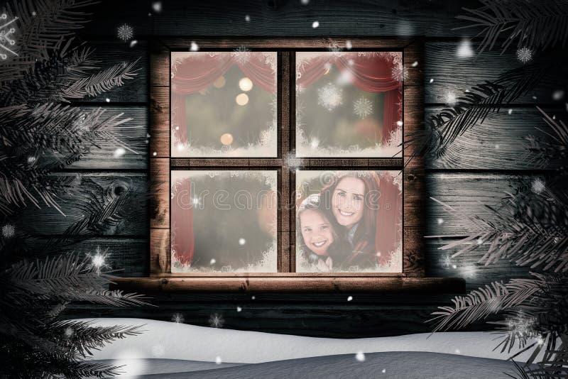 Zusammengesetztes Bild der Mutter und der Tochter unter Decke stockbild