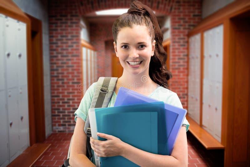 Zusammengesetztes Bild des lächelnden Studenten lizenzfreie stockfotografie