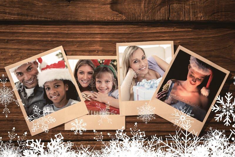 Zusammengesetztes Bild des Porträts eines Vaters und des Sohns, die ein Weihnachtsgeschenk halten stockbilder
