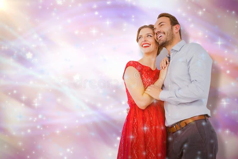 Zusammengesetztes Bild von den jungen Paaren, die sich umfassen lizenzfreies stockfoto