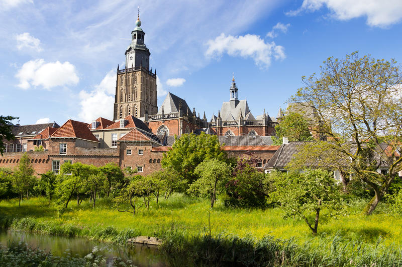 Zutphen - The Netherlands. View on the St. Walburgis Church and the city wall of the historic city of Zutphen. Gelderland, The Netherlands royalty free stock photography