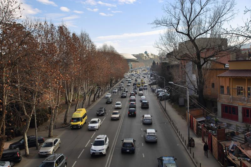 Zviad Gamsakhurdia embankment in Tbilisi city, Georgia. Lively traffic is characteristic of the big streets of Tbilisi city. Zviad Gamsakhurdia was a Georgian stock image