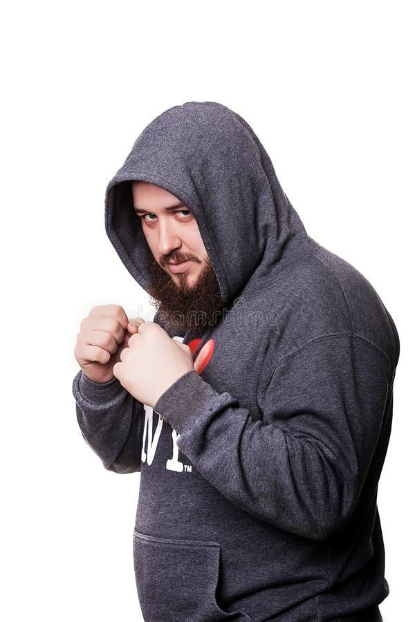 Zwaargewicht bokser indien met een grote baard in de kap dichtgeklemd F royalty-vrije stock afbeelding