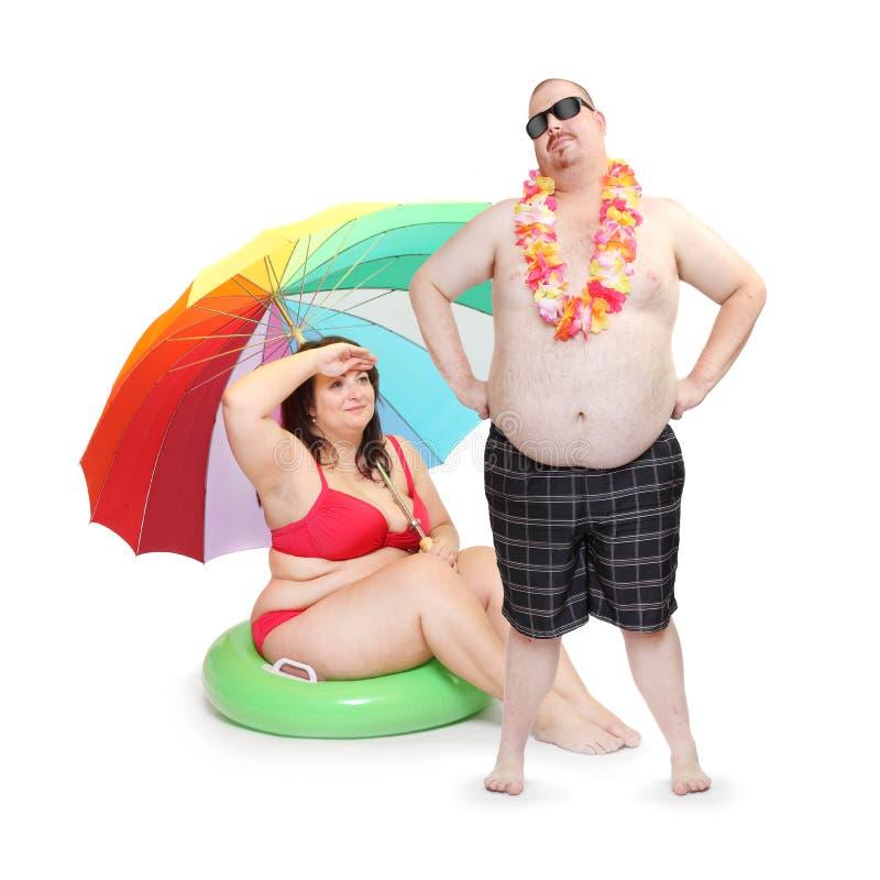 Zwaarlijvig paar op het strand royalty-vrije stock afbeelding