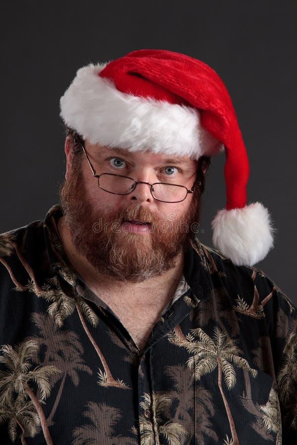 Zwaarlijvige Mens In De Hoed Van De Kerstman Royalty-vrije Stock Afbeeldingen