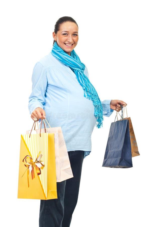 Zwanger lachen bij het winkelen royalty-vrije stock fotografie