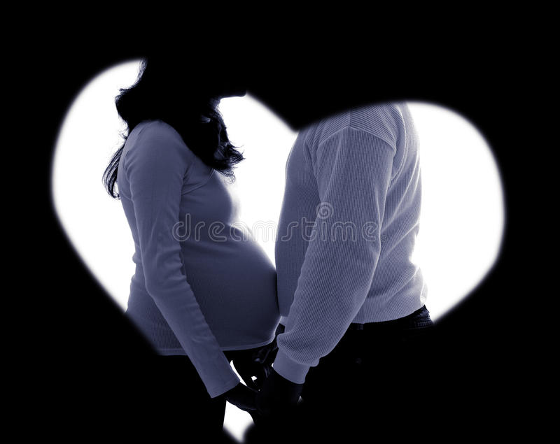 Zwanger paarsilhouet in rustig royalty-vrije stock fotografie