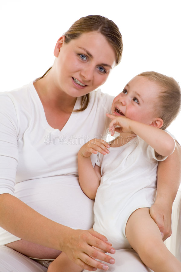 Zwangere mamma en baby stock fotografie