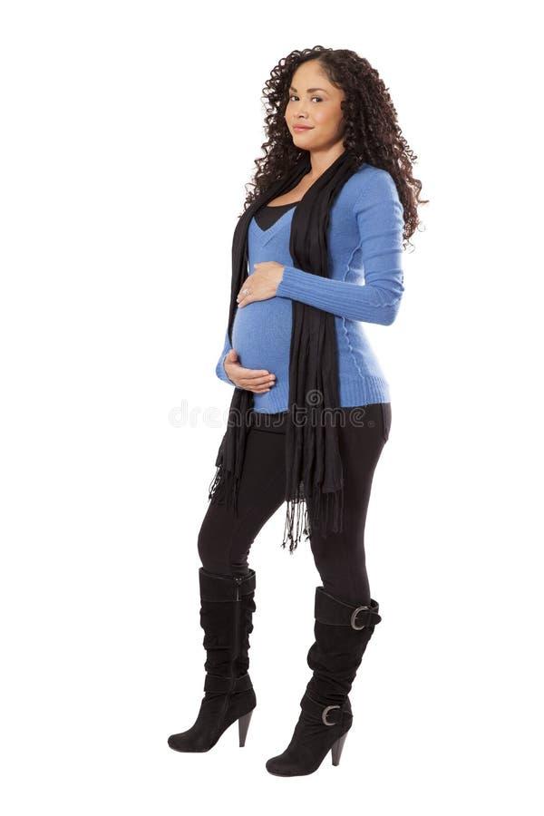 Zwangere vrouw in de winterkleding. royalty-vrije stock afbeeldingen