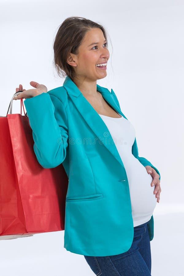 Zwangere vrouw die uit winkelen royalty-vrije stock afbeelding