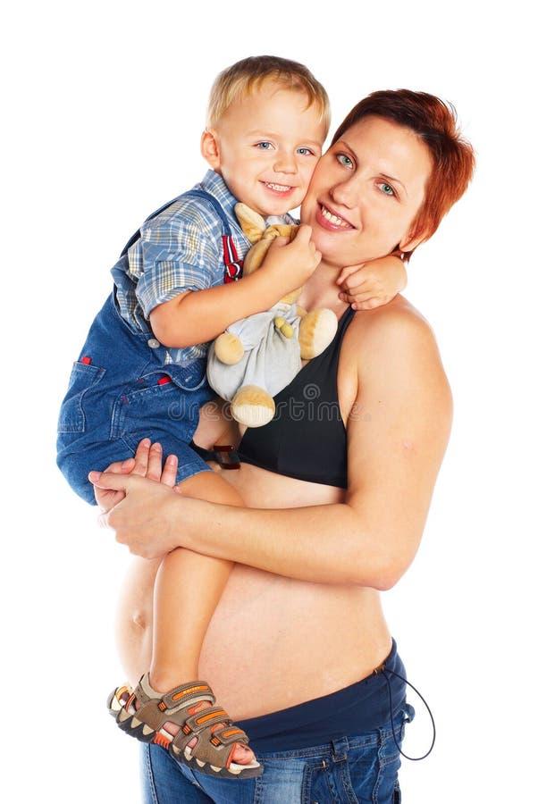 Zwangere vrouw met kind stock fotografie