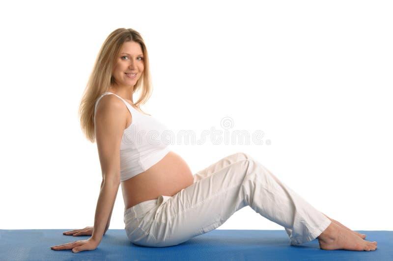 Zwangere vrouwenzitting royalty-vrije stock afbeelding