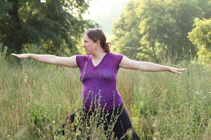 Zwangerschap en yoga royalty-vrije stock foto