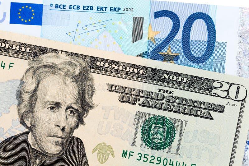 Zwanzig Dollar gegen Euro zwanzig lizenzfreie stockbilder