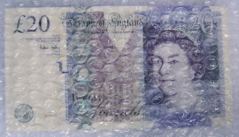Zwanzig Pfund-Anmerkung unter Luftblasen-Verpackung lizenzfreies stockfoto