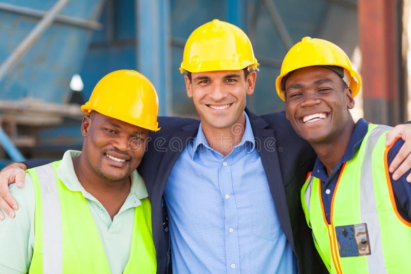 Zware industriearbeiders royalty-vrije stock afbeeldingen