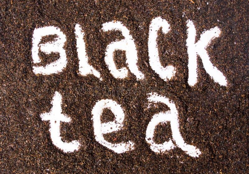 Zwart die theeetiket in korrels wordt gestempeld royalty-vrije stock foto's