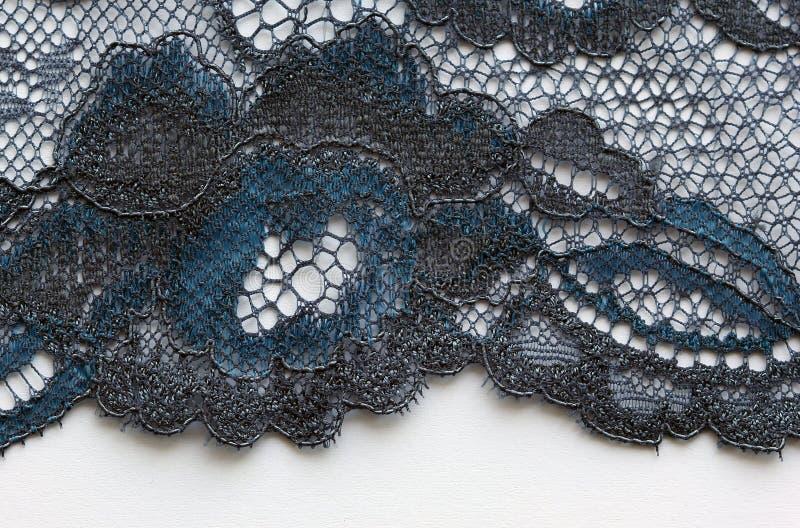 Zwart en blauw materieel de textuur macroschot van het bloemenkant royalty-vrije stock afbeelding