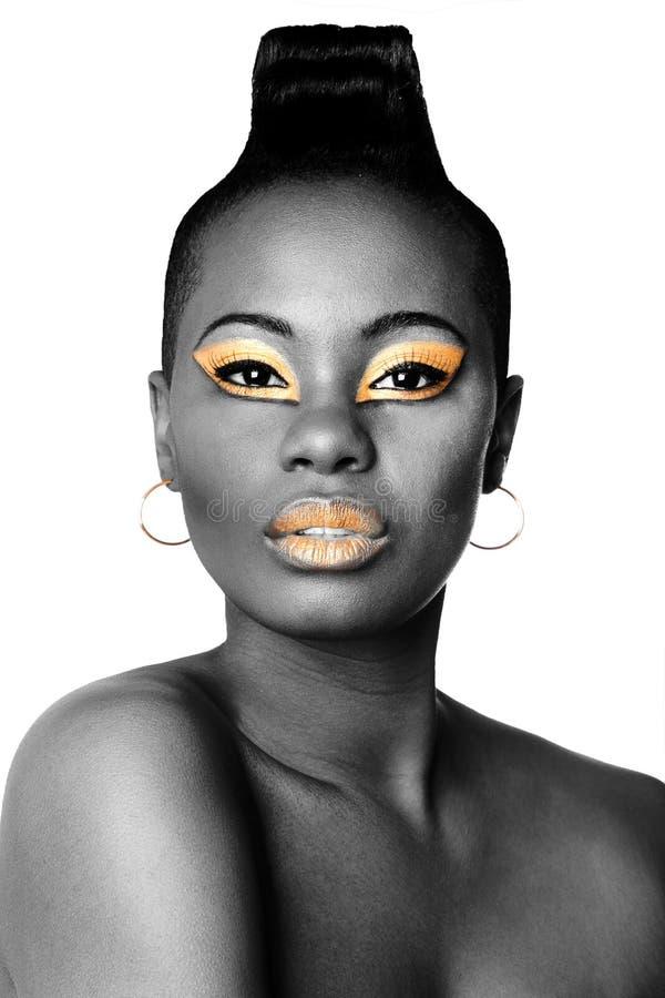 Zwart en gouden schoonheidsgezicht royalty-vrije stock afbeelding