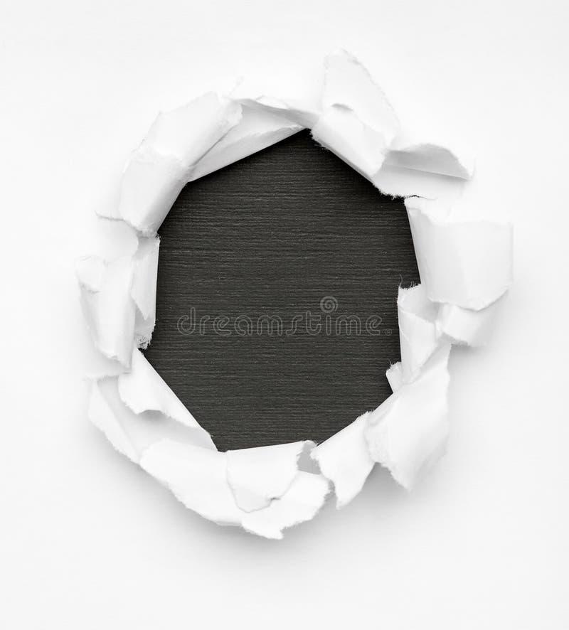 Zwart gat in Witboek royalty-vrije stock afbeeldingen