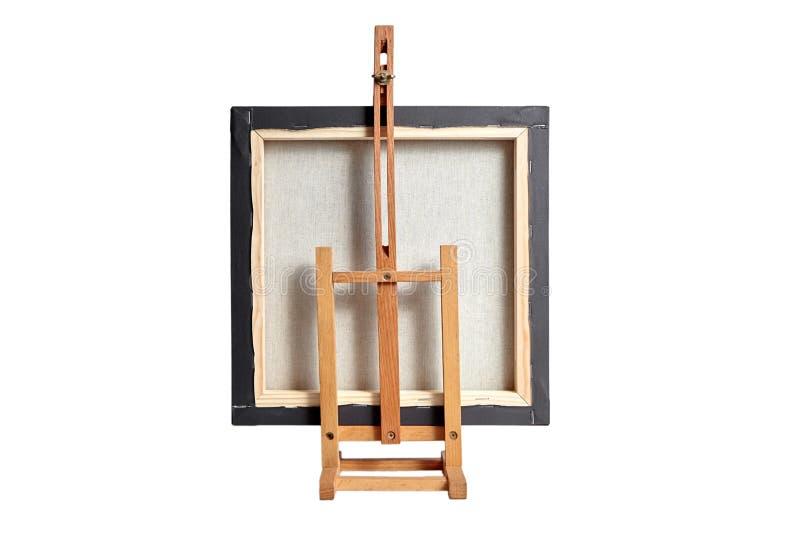 Zwart katoenen die canvas op subframe en een houten die lijstschildersezel wordt uitgerekt, op witte achtergrond wordt geïsoleerd royalty-vrije stock foto