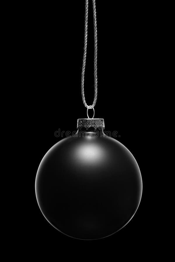 Zwart Kerstmisornament op een zwarte achtergrond royalty-vrije stock afbeeldingen