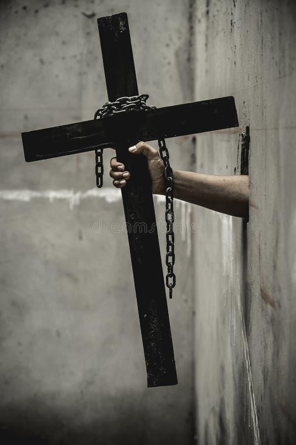 Zwart kruis met een van een lus voorzien ketting stock afbeeldingen