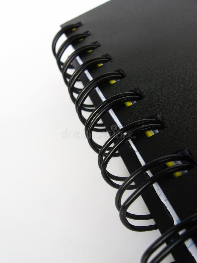 Zwart notitieboekje stock foto's