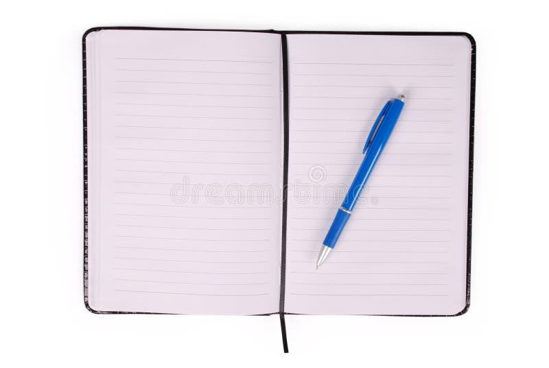 Zwart notitieboekje en blauw handvat stock afbeeldingen