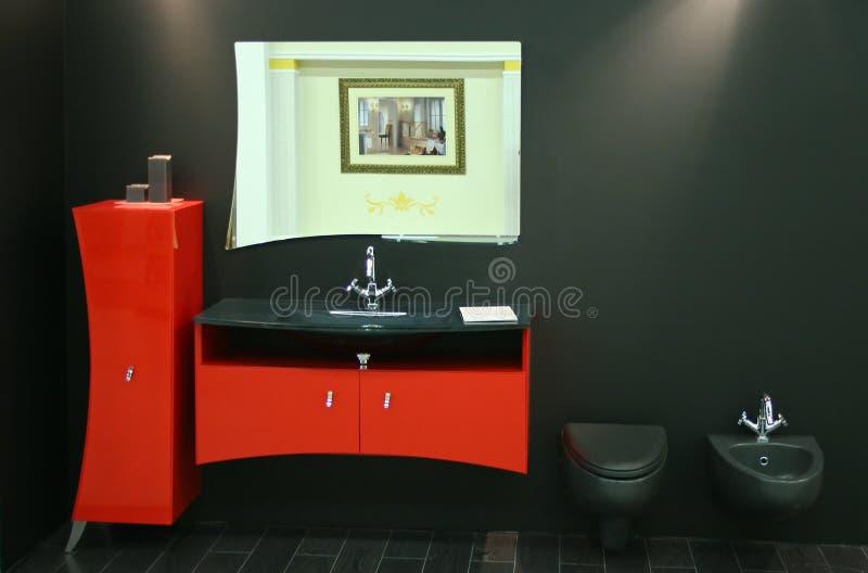 Zwart rood toilet stock foto's