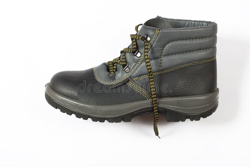 Zwart schoeisel, apparatuur voor arbeiders royalty-vrije stock afbeeldingen