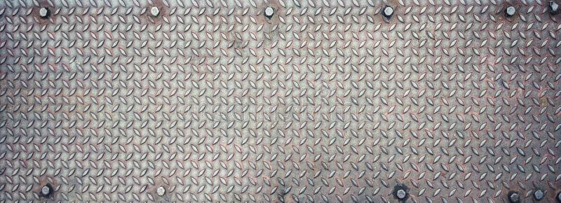 zwart staalmetaal met een patroon achtergrondtextuur en een behang stock foto's