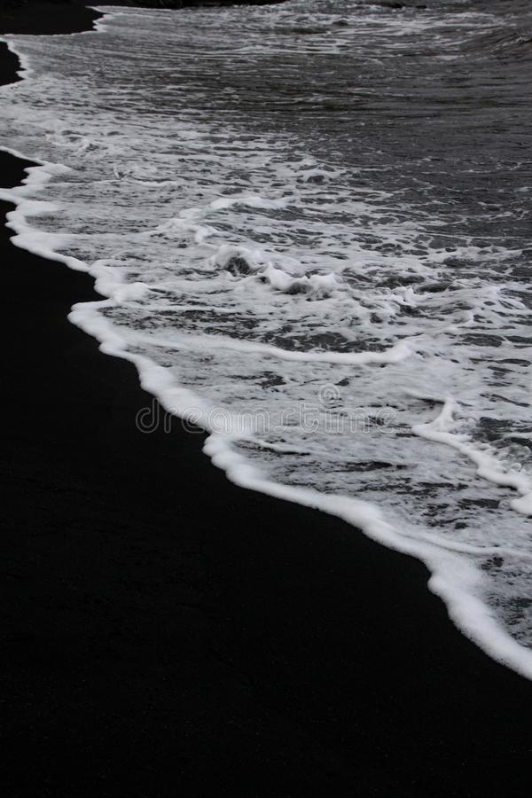 Zwart strand stock afbeelding