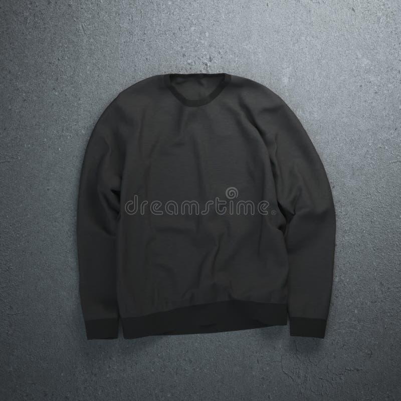 Zwart sweatshirt op de concrete vloer royalty-vrije stock afbeelding