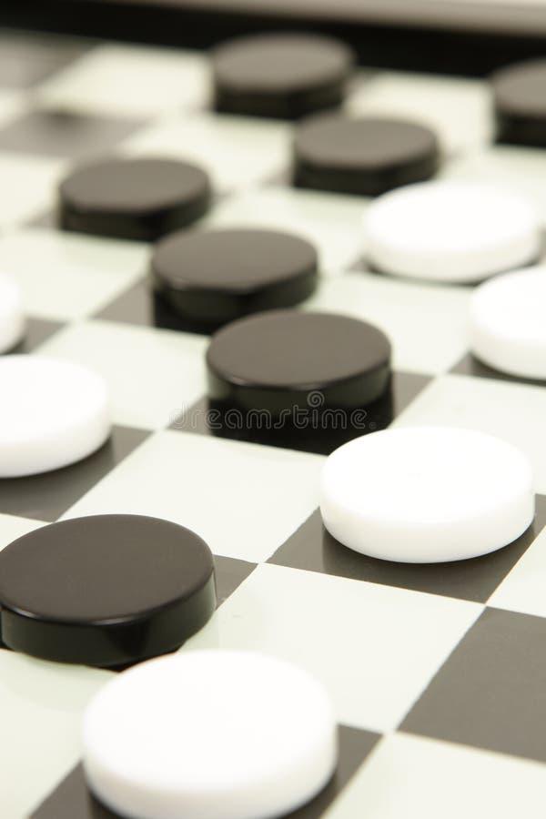 Zwart-wit raadsspel stock foto